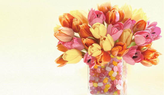 tulips in a vase filled with jelly beans + Happy Mother's Day