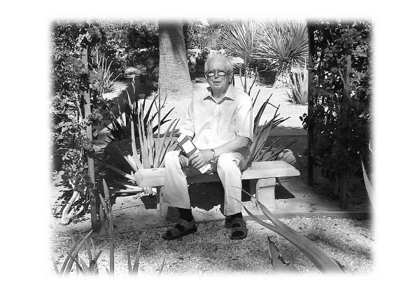 John sitting on an outdoor bench