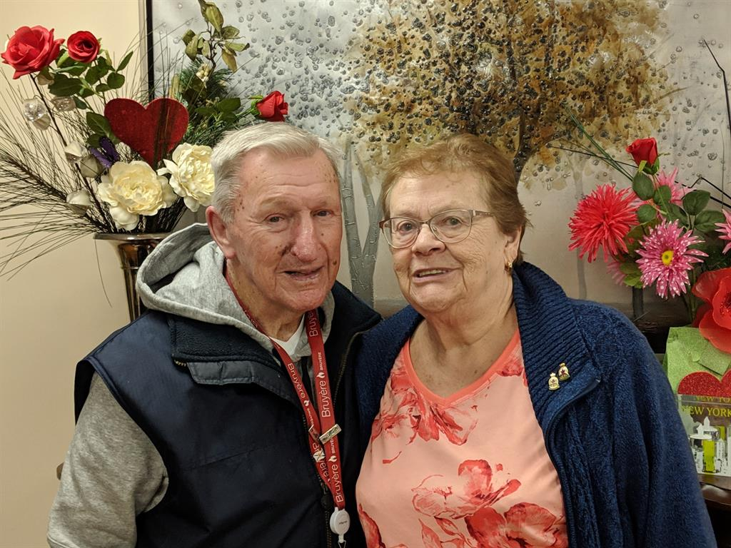 a senior couple smilling