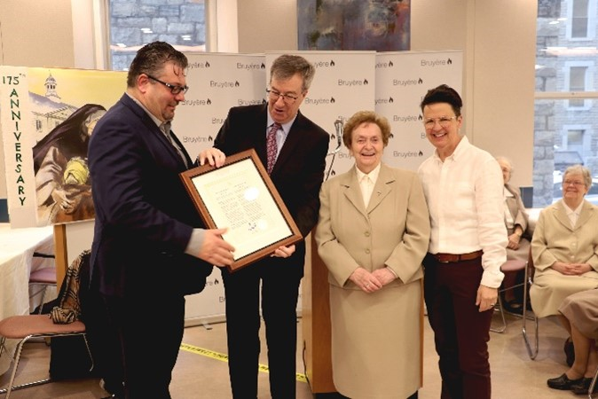 Bruyère President and CEO Guy Chartrand, Mayor Jim Watson, Sister of Charity, and City councilor Catherine McKenney celebrate Élisabeth Bruyère Day