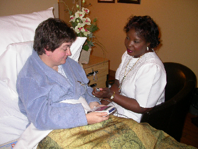 Patient in bed receiving care from a nurse